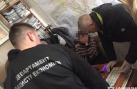 В Днепропетровской области чиновники горсовета попались на взятке