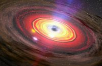 Астрономы обнаружили гигантскую черную дыру времен ранней Вселенной