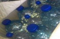 Днепровская полиция задержали водителя, который перевозил более 300 литров незаконного спирта